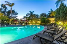 Ramada Santa Barbara Amenities - Pool with Lounge Chairs